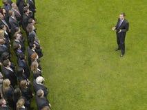 Businessman Facing Group Of Executives Stock Photography