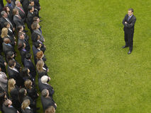 Businessman Facing Group Of Executives Royalty Free Stock Image
