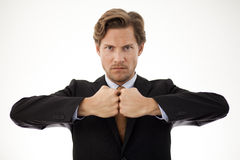 Businessman facing his fists in a sign of strength Stock Photos