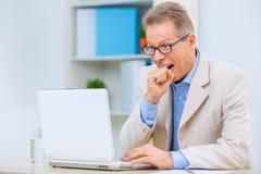 Businessman facing serious problems Stock Photography