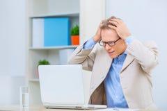 Businessman facing some problems Stock Photo
