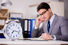 The businessman failing to meet the deadlines Stock Photo
