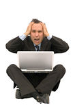 Businessman failure. Businessman looking computer and discover catastrophic news Royalty Free Stock Photos