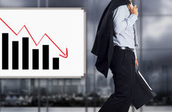 Businessman with failure chart stock photography