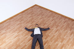 Businessman fainted on the office floor Royalty Free Stock Photography