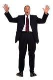 Businessman falling. Backwards against a white background Royalty Free Stock Image