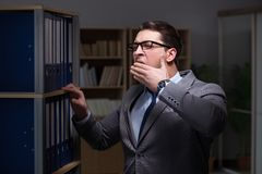 Businessman almost falling asleep working late hours in the offi. Ce Stock Photos