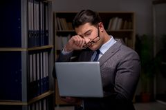 Businessman almost falling asleep working late hours in the offi. Ce Royalty Free Stock Photography