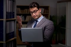 Businessman almost falling asleep working late hours in the offi. Ce Stock Images