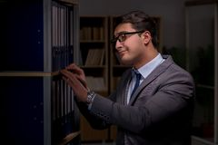 Businessman almost falling asleep working late hours in the offi. Ce Royalty Free Stock Image