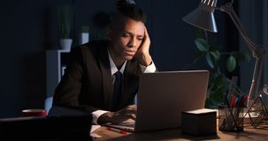 Businessman falling asleep while working late night in office stock footage
