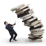 Businessman with falling books Royalty Free Stock Photo
