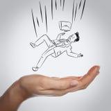 Businessman falling down on hand. Businessman in art form falling down on hand means safe Stock Photos