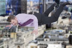 Businessman falling down with modern city in Stock Images