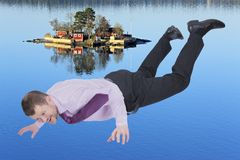 Businessman falling down and sea island in background Stock Photo