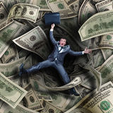Businessman falling into financial tunnel Royalty Free Stock Images