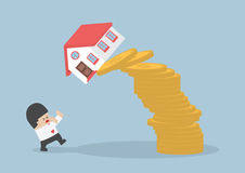 Businessman and falling house and coins Stock Images
