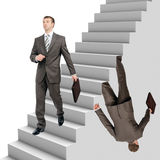 Businessman falling out of stairs Stock Photo
