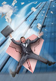 Businessman falling on paper airplane. Scared businessman on paper airplane falling from business building stock photography