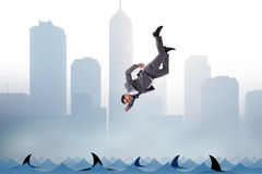 The businessman falling into sea with sharks Stock Photos