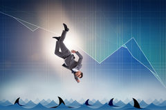 The businessman falling into sea with sharks Stock Images