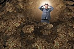 The businessman falling into sinkhole of cryptocurrency bitcoin Royalty Free Stock Photo