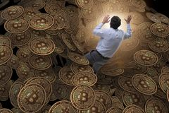 The businessman falling into sinkhole of cryptocurrency bitcoin Stock Photo