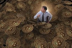 The businessman falling into sinkhole of cryptocurrency bitcoin Royalty Free Stock Image
