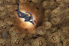 The businessman falling into sinkhole of cryptocurrency bitcoin Stock Images
