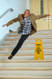 Businessman Falling on Stairs Stock Image