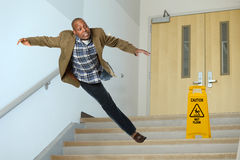 Businessman Falling on Stairwell Royalty Free Stock Photos