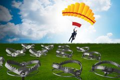 The businessman falling into trap on parachute. Businessman falling into trap on parachute Royalty Free Stock Photos
