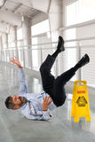 Businessman Falling on Wet Floor Stock Photography