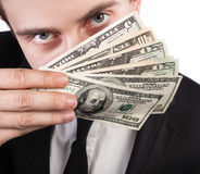 Businessman with a fan of dollars Royalty Free Stock Photography