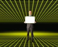 Businessman in fantastic place. Happy businessman holding blank white card in his hands, in fantastic place Stock Image
