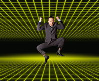 Businessman in fantastic place. Happy businessman jumping in air isolated on white background, in fantastic place Stock Images