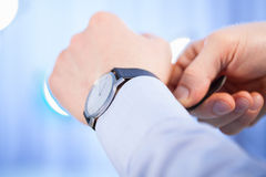 Businessman fastening a bracelet of swatch Stock Photography