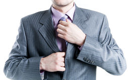 Businessman fastening tie stock photos