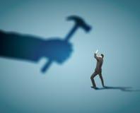 Businessman fears. Shadow hammer blow stock photos