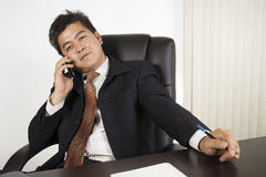 Businessman feeling happy at work Stock Photo