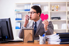 The businessman feeling love and loved in the office Royalty Free Stock Photo