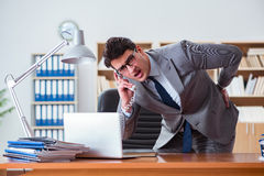The businessman feeling pain in the office. Businessman feeling pain in the office Royalty Free Stock Image