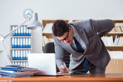 The businessman feeling pain in the office. Businessman feeling pain in the office Royalty Free Stock Photography