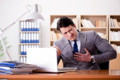 The businessman feeling pain in the office Royalty Free Stock Photography