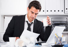 Businessman feeling thirsty in hot office Royalty Free Stock Image