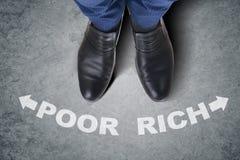 The businessman feet facing difficult choice dilemma Stock Photo