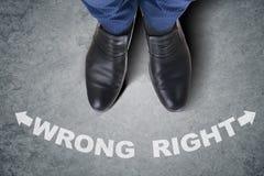 The businessman feet facing difficult choice dilemma Royalty Free Stock Photo