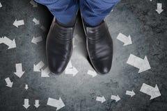 The businessman feet facing difficult choice dilemma. Businessman feet facing difficult choice dilemma Stock Photos