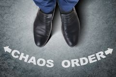 The businessman feet facing difficult choice dilemma. Businessman feet facing difficult choice dilemma Stock Photo