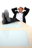 Businessman With Feet On The Table Royalty Free Stock Image